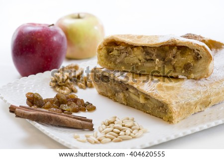 strudel cake cut in half on a tray with ingredients - stock photo
