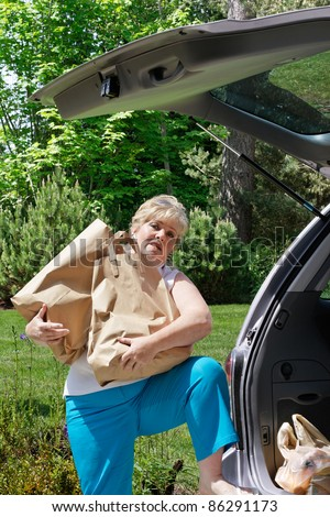 Struggling with the mounds of bags - stock photo