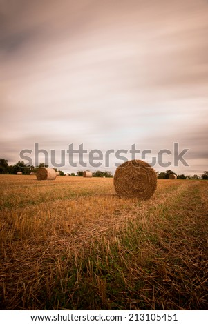 stubble field with bales of straw