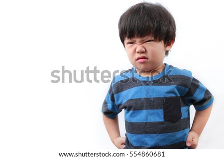 Stubborn, sad, upset little Asian boy isolated over white background.Facial expression.
