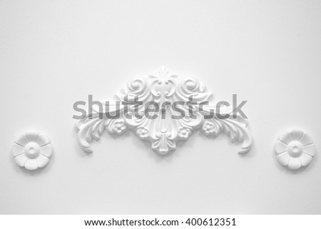 Stucco elements on white wall - stock photo