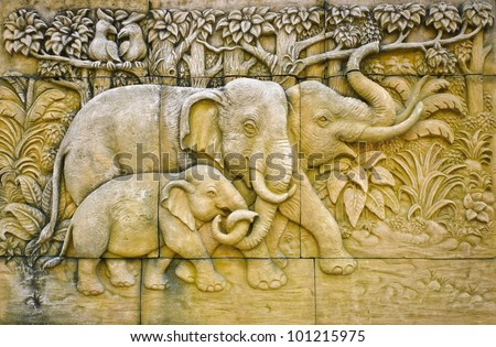 Stucco of elephant family - stock photo
