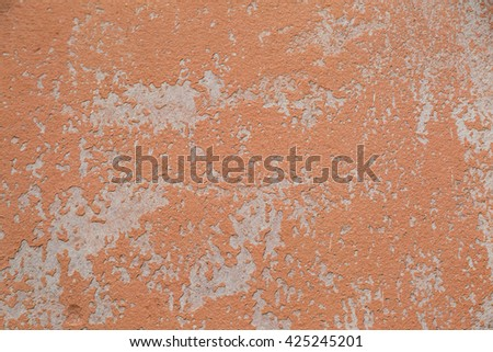 Stucco wall - Orange stucco textured wall background with natural light. - stock photo