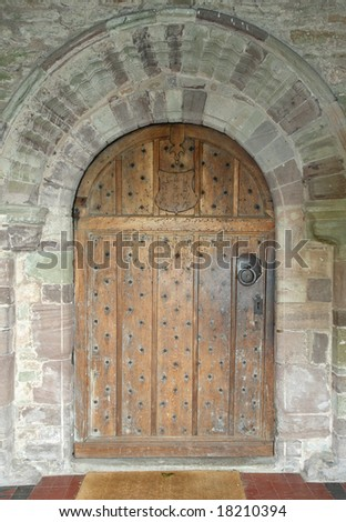 Studded Medieval Wooden Door to an English Church - stock photo