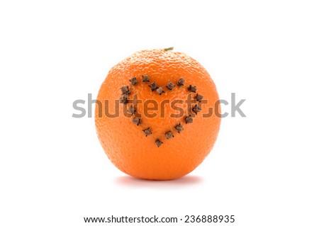 Studded orange on white background - stock photo