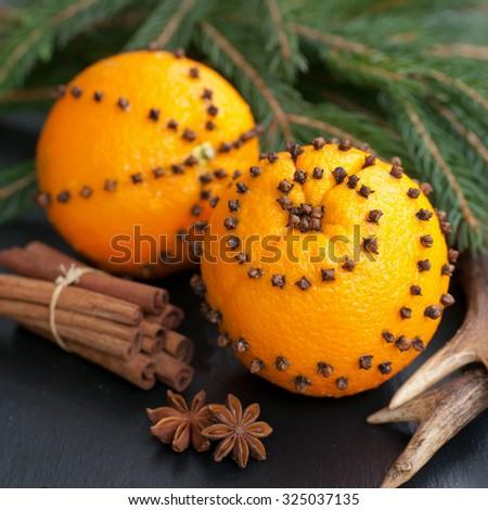 Studded oranges - stock photo