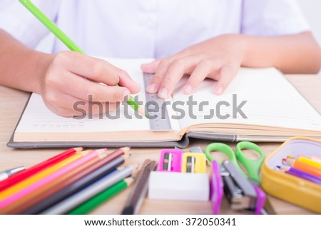 student and school supplies on wood background. Back to school. - stock photo