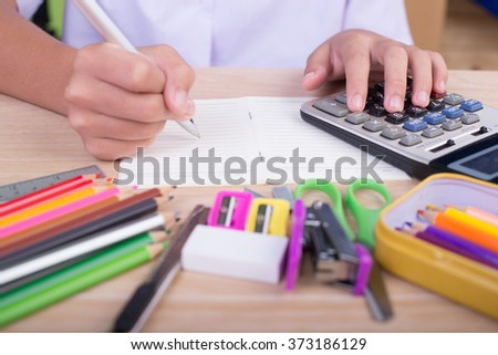 student and school supplies on wood table. Back to school. - stock photo