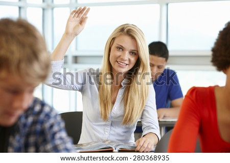 Student asking question in class - stock photo