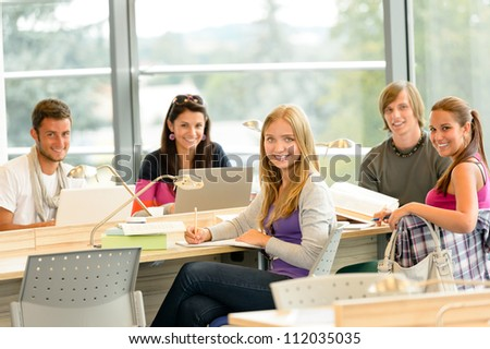 Student back to school in library study computer notes books - stock photo