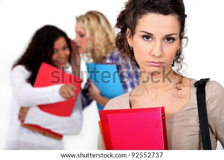 Student being gossiped about - stock photo