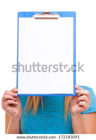 Student blank banner sign. Girl female college student holding clipboard with empty blank copy space for text and covering her face. Isolated on white background - stock photo