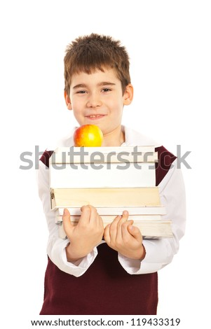 Student boy carrying stack of books and apple isolated on white background