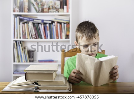 Student boy read the book at home