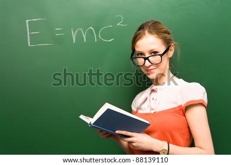 Student by chalkboard with e=mc2