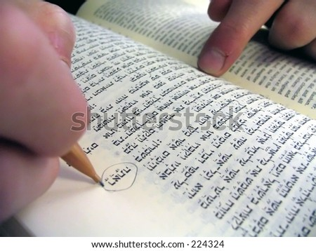 student circling in the bible - stock photo