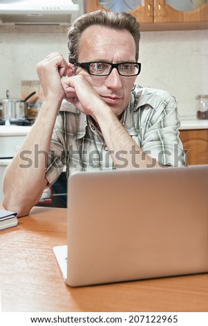 student do his homework on the kitchen table. - stock photo
