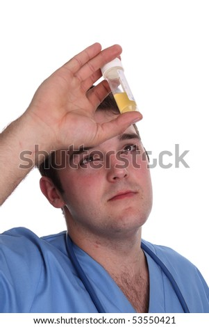 Student Doctor in a scrubs top checking a sample - stock photo