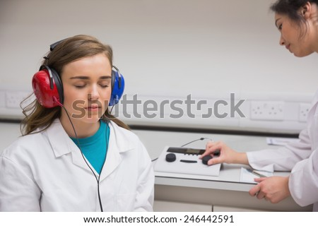 Student doing a hearing test at the university - stock photo