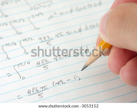 Student doing calculus homework. - stock photo