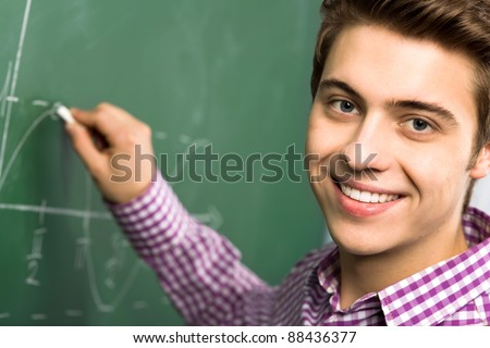 Student Doing Math on Chalkboard - stock photo