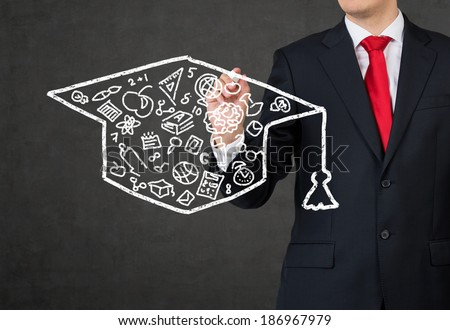 Student drawing a graduation hat - stock photo