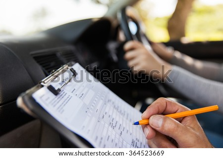 student driver taking driving test - stock photo