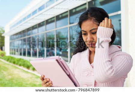 Student failed exam. Stressful girl touching her and holding tablet outside
