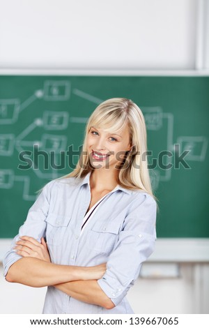 Student female arms crossed inside the classroom