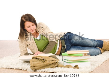 Student female teenager read homework with book on white background
