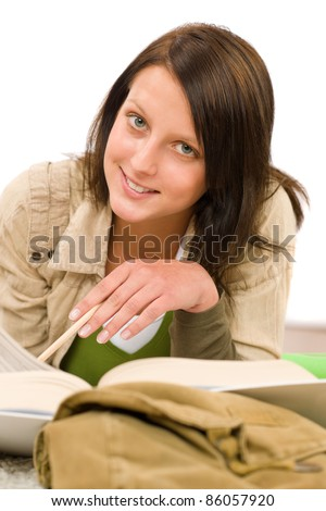 Student - female teenager write homework with book on white background