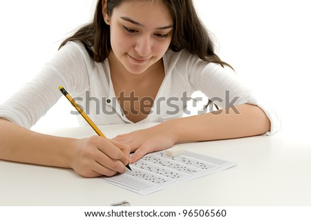 Student filling out answers to a test with a pencil. - stock photo