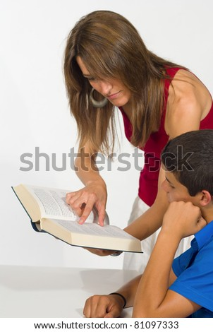 Student getting help from a female teacher - stock photo