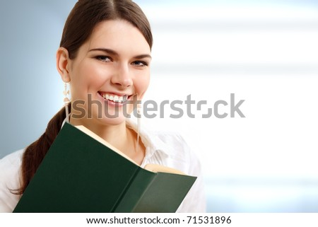 student girl cheerful with book