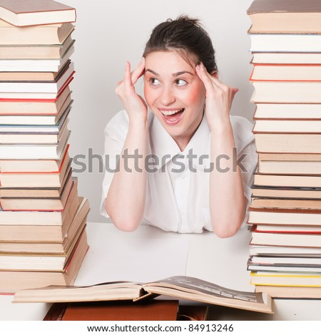 Student girl holding fingers on head - she get tired from leraning and have a bad headache - stock photo