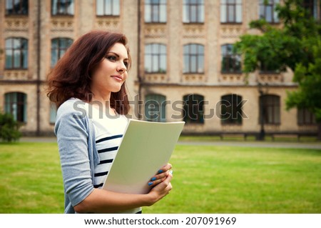 student girl on the university building background