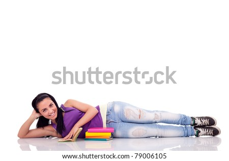 student girl relaxing on floor , smiling and looking at camera, isolated on white - stock photo