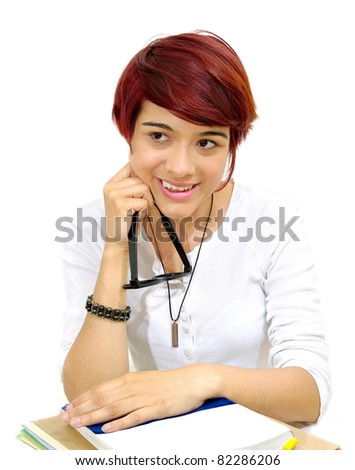 Student girl  smiling with eye glasses in hand and school book . white background   - stock photo