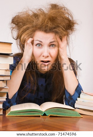 Student girl with books shows panic expression - stock photo
