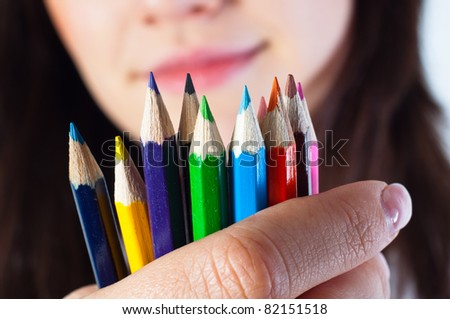 Student girl with colored pencils - stock photo