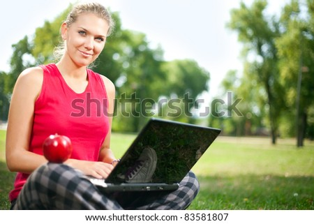 student girl with laptop no break in park - stock photo