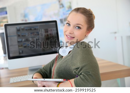 Student girl working on desktop computer - stock photo