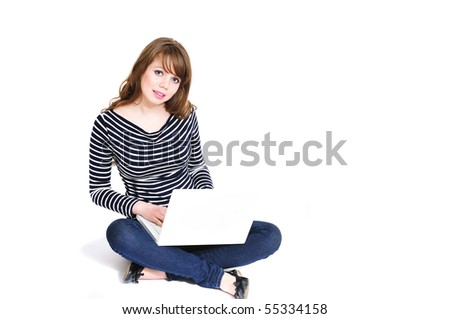 student girl working on laptop and sitting on the floor - stock photo