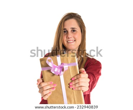 Student giving a present over white background - stock photo