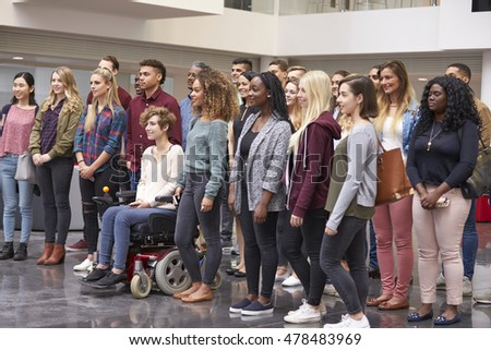 Student group standing in university atrium looking away