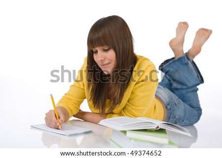 Student - Happy female teenager write homework with book on white background