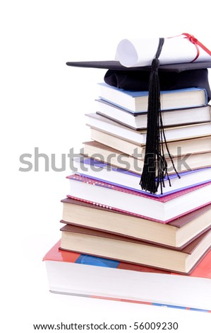 Student hat on a tower made of books, against a white background - Education concept - stock photo