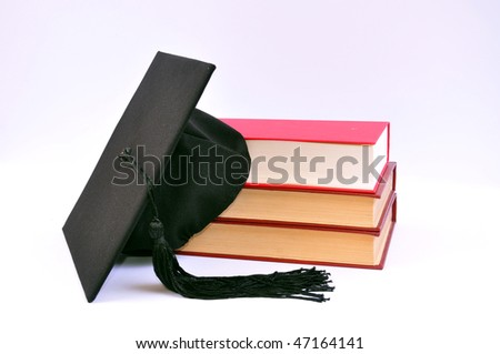 Student hat on books on white, - stock photo