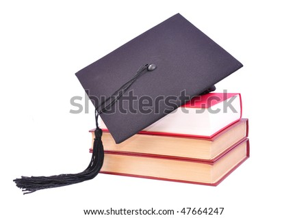 Student hat on books, on white with clipping path - stock photo