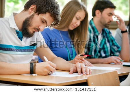 Student have test in classroom - stock photo